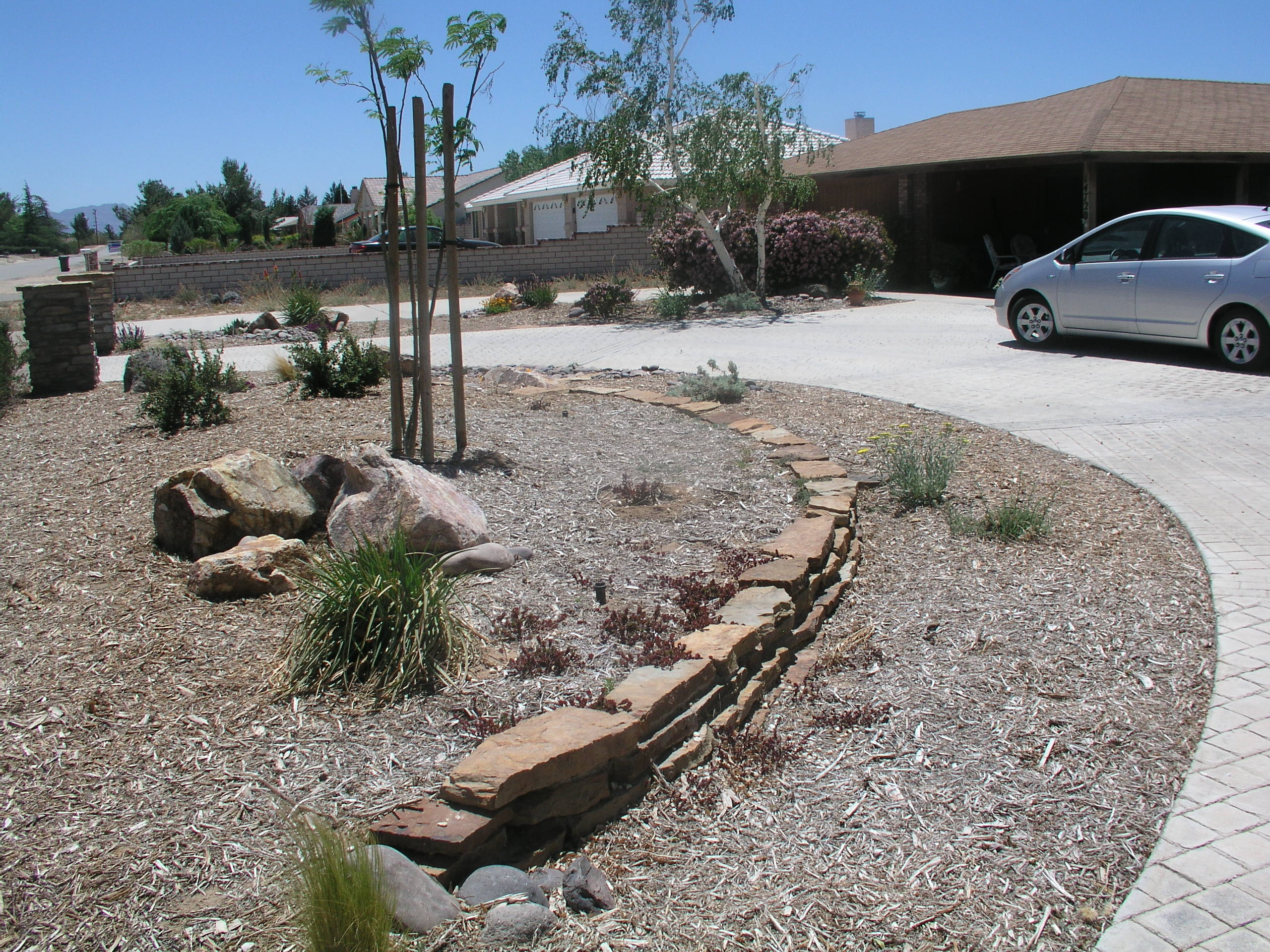 Natural stone dry stacked wall high desert landscaping for Landscape rock upland ca